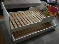 A TODDLER BED. 143cm long. Great price and condition.