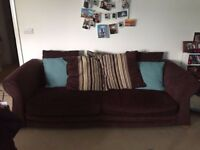 Barely used brown sofa with cushions