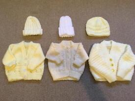 Handmade knitted baby cardigans and hats