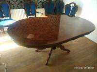 Large dining table with 6 chairs.