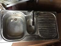 Kitchen Sink with mixer tap and pipes