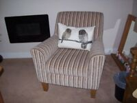 Yellow, cream and brown striped easy chair
