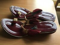 gold and burgundy slip on shoes