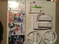 Wii plus games & steering wheels