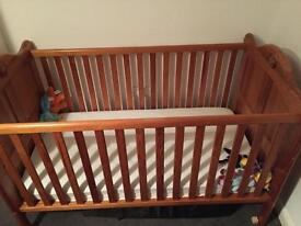 Cot bed and chest of draws including change station