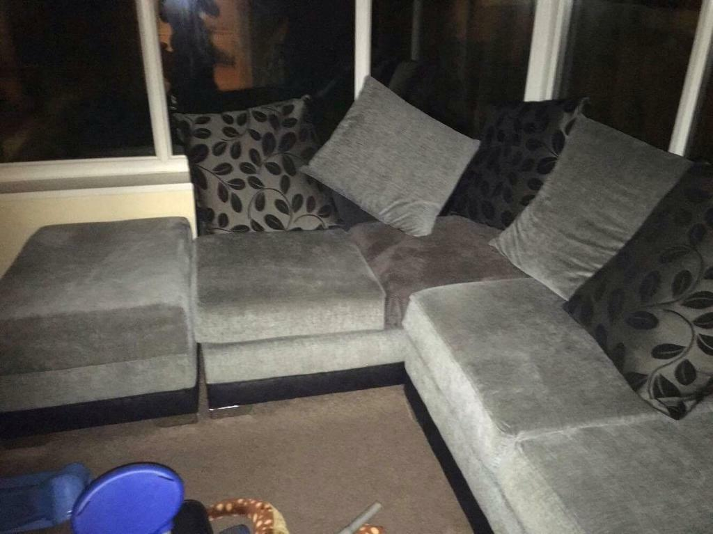 Corner sofa and puffein Middlesbrough, North YorkshireGumtree - Corner sofa and puffe £300 Ono. Only bought a few months back and now doesnt go with our newest furniture(my man chair) so we are getting rid. It has a small burn on the corner cushion but we have covered it with a grey throw that covers it...