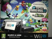 WiiU console with lots of extras and 12 games