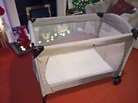 Mothercare travel cot with bassinet. Adjustable height. Excellent condition - smoke/pet free.