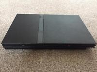 PS2 slimline console. 1 control pad. 3 games.