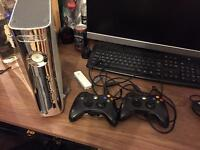 Xbox 360, two controllers lots of games GTA IV