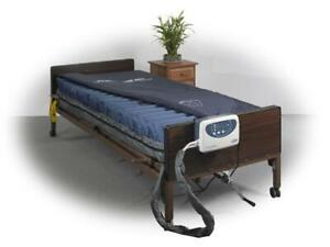 used fully electric hospital bed   Med-Aire Alternating Pressure and Low Air Loss Mattress System call me @ 647-781-8987