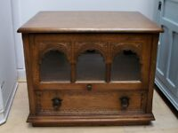 Old charm oak tv display unit / stand with retractable glass door and carvings.
