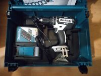 Brand new makita 2x4ah LXT battery, makpac case, fast charger and dhp482 18v LXT combi drill (used)