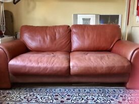 Leather sofa, three seater, antique red, good condition.