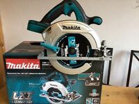 new makita 2x18v skill saw dhs710, with 185mm blade. 36v lxt dhs710z
