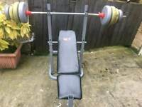 Weights bench with barbell and weights