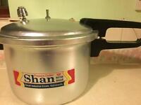 8 litre pressure cooker. Brand new. Never been used.