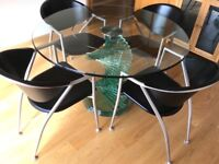 Tweera glass dining table and 4 chairs