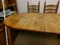 Dining table (expandable) and 4 chairs