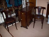 Drop Leaf Dinning Table and two chairs.