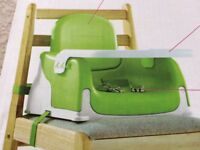 Booster seat for chair. Green hardly used as was bought for grandparents house.