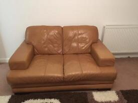 Two seater tan leather settee