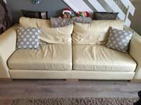 Cream leather four seater couch and chair