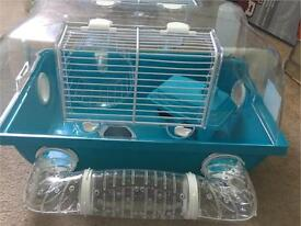 Hamster / gerbil cage. Hardly been used. Not a mark on it. Comes with accessories shown in pic.