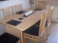 beech table and 6 chairs