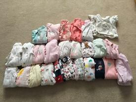 21 Up to 1 month babygrows in good condition some never even worn.