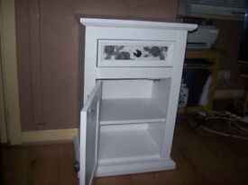 A pair of side cupboards