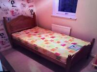 Wooden single bed with mattress very good condition