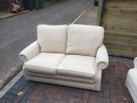 Pair of 2 seater sofas cream