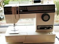 Singer Sewing Machine, with Instructions, dust cover and accessories