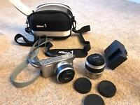 Nikon camera and Velbon tripod