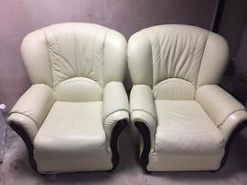 Two single leather chairs
