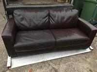 Large brown leather sofa bed. Good quality mattress