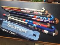 Collection of 8 used hockey sticks in a Slazenger carry case. All in decent condition