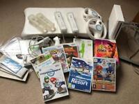 Wii bundle including Wii Fit board and 8 games