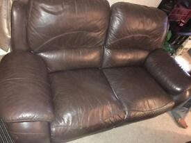 Two brown leather reclining sofas
