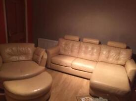 Leather sofa bed, double swivel chair and half moon footstool