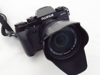 Fujifilm X-T! camera with 16-50mm lens. Immaculate condition.