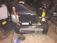 Air compressor with air tools and air line
