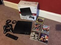 PS3 Slimline Playstation 3 - 2 Controllers - Blu Ray Remote - 5 Games