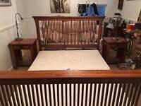 Dark American hardwood king size bedstead and bedside tables