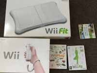Wii in excellent condition with accessories - all boxed and well kept