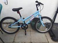 Pale blue girls bike