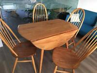 Retro fashionable Ercol Table and four chairs.