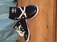Woman's black adidas trainers