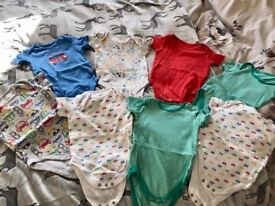 8 vests - size 12-18 months - not worn.